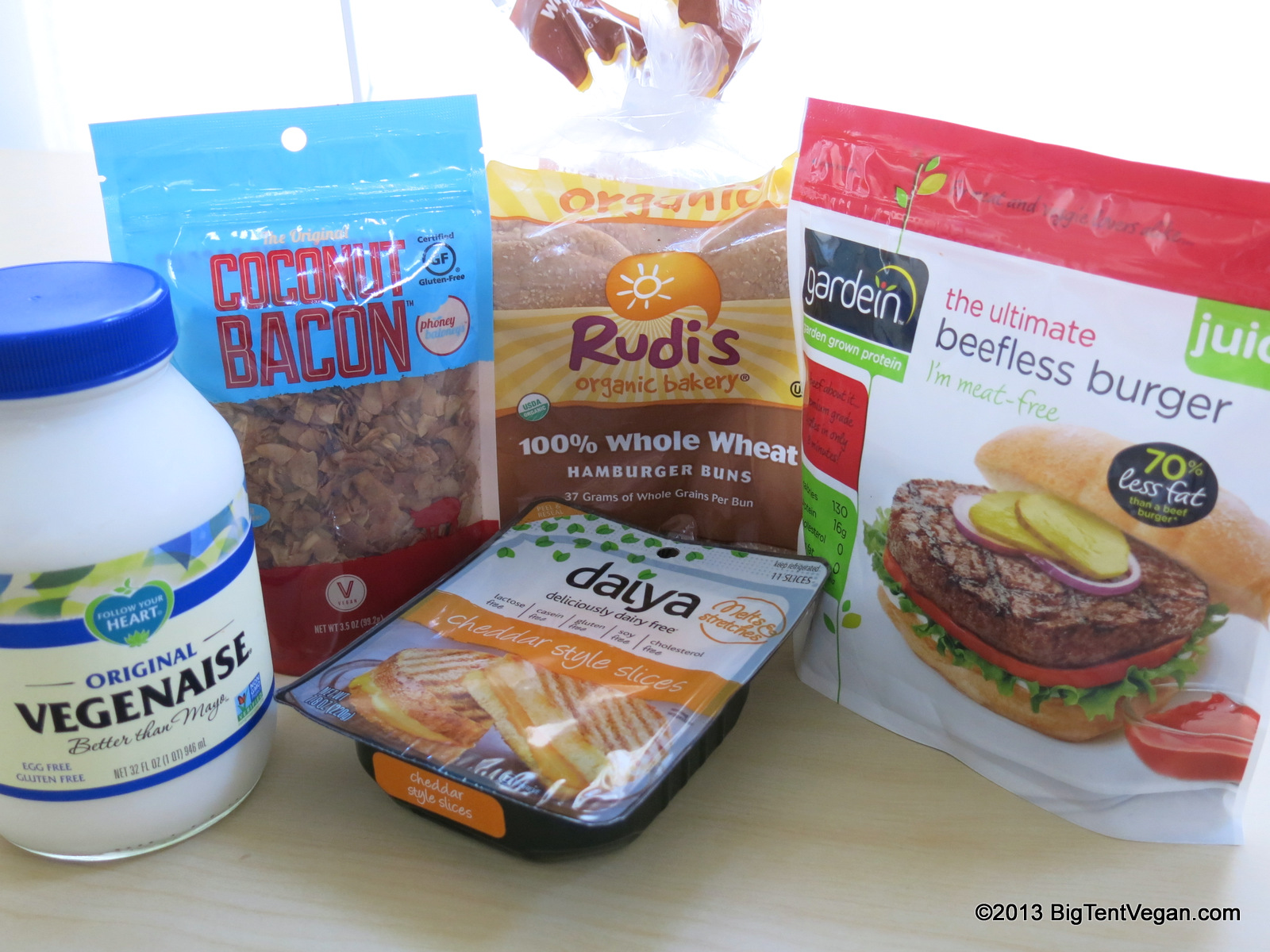Ingredients used to make our Vegan Bacon Cheeseburgers at home:  Vegenaise Mayo ,  Phoney Baloney's Coconut Bacon ,  Daiya Cheddar Style Slices ,  Rudi's Whole Wheat Buns , and  Gardein Beefless Burgers .