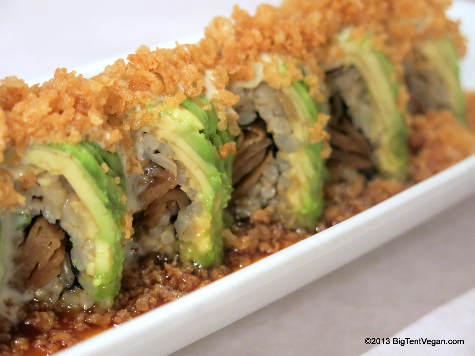 Crunchy Tiger, Hidden Dragon: BBQ Seitan, Tempura Asparagus, & Avocado Roll topped with Crunchy Tempura Batter, drizzled with Wasabi Mayo and Sweet Soy Sauce.