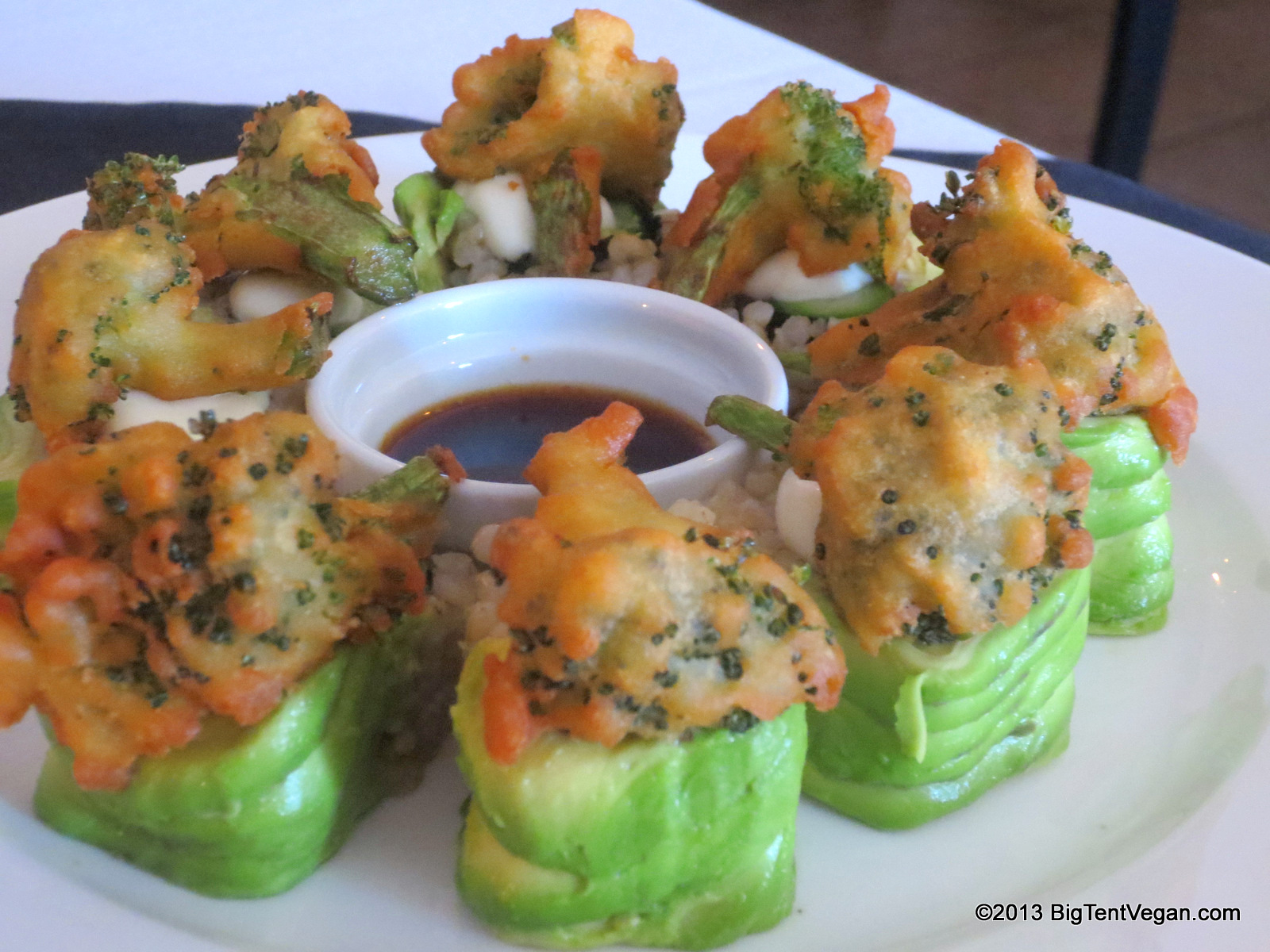 Green Forest: Asparagus and Carrot Roll wrapped in Avocado slices, topped with Tempura Broccoli and Yuzu Citrus Mayo, served with Ginger Soy Sauce.