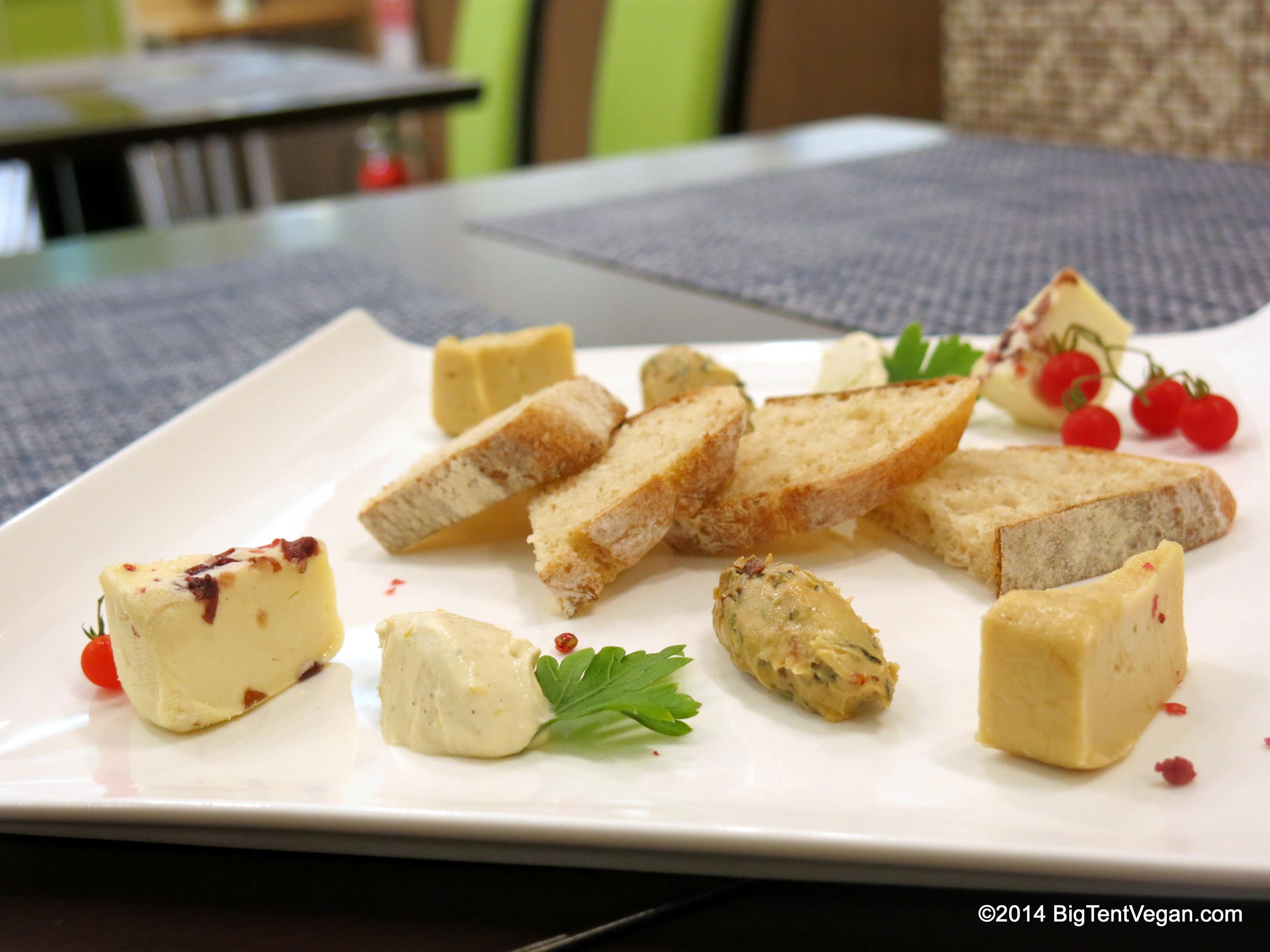 Artisan vegan cheese plate based on miyoko Schinner's recipes, from 100% vegan choice cafe in kyoto, japan.