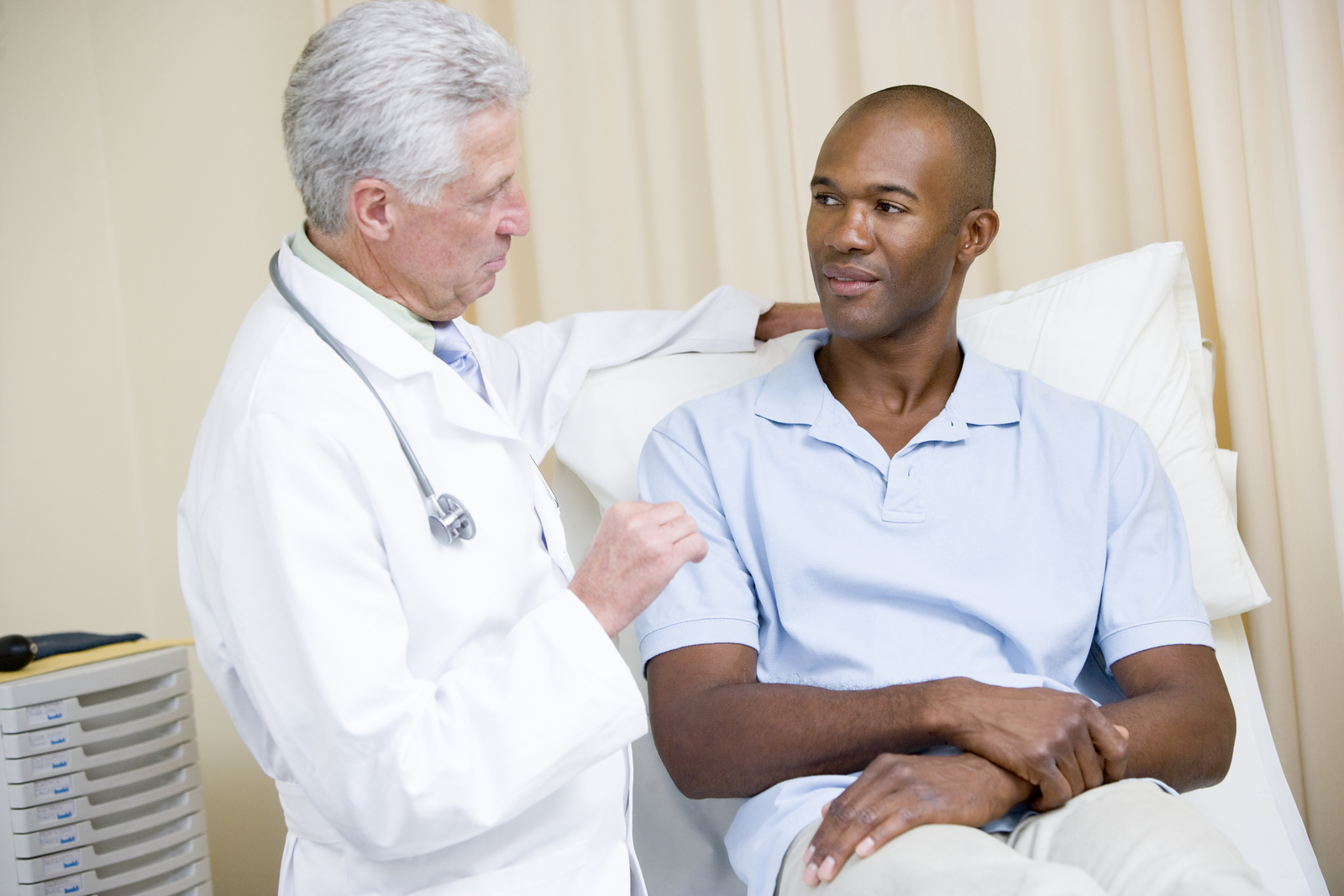Doctor-Giving-Man-Checkup-Palliative-Care