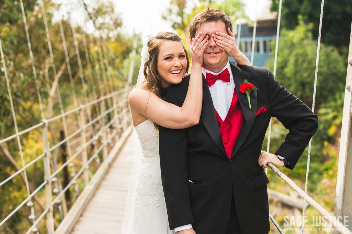 23 Spruce Street Suspension Bridge bride and groom.jpg