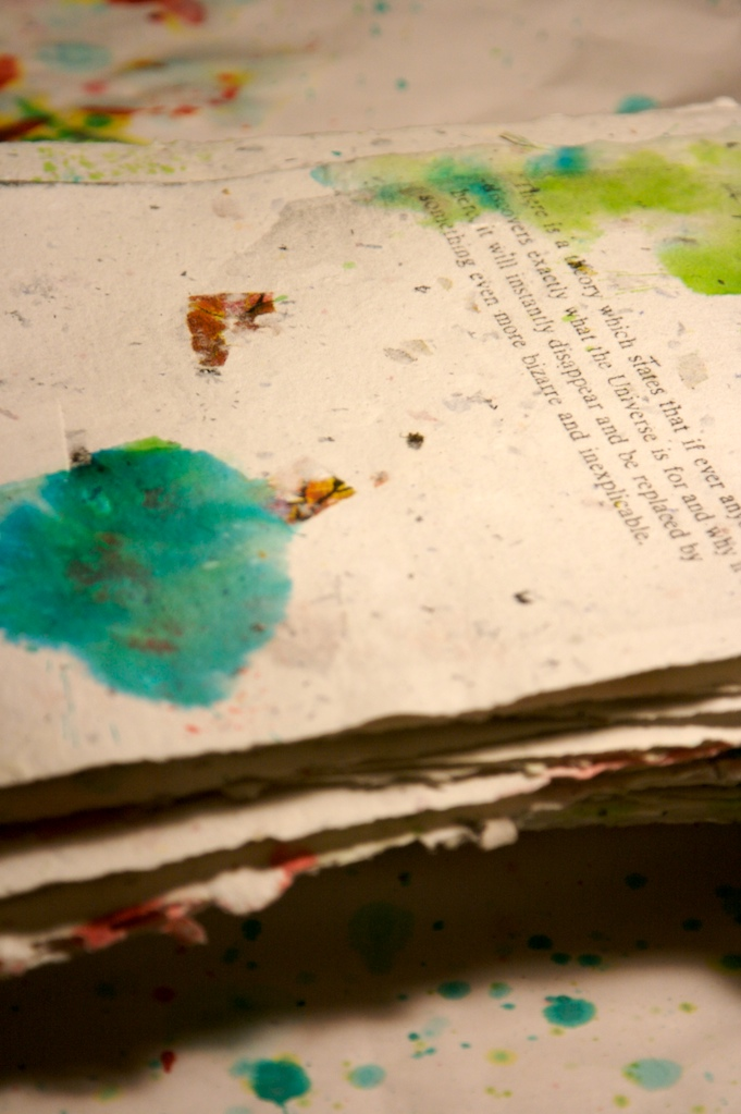 Handmade paper with solvent transfer printing and watercolour. Text from  The Hitchhiker's Guide to the Galaxy  by Douglas Adams. 2008.