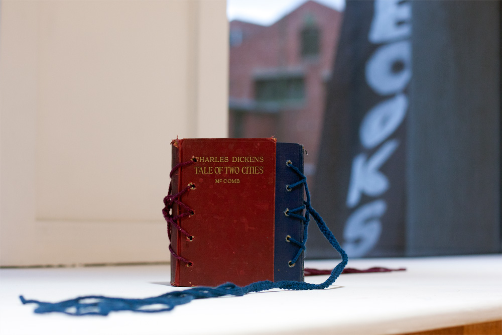 A tale of two forces (it was the friction that brought them together, it was the tension that threatened to tear them asunder)  Artist's book:  A Tale of Two Cities  (Ward Lock, 1928),  A Tale of Two Cities  (Lyons & Carnahan, 1934), ink, hand dyed & knit wool. 2012. Created for the  What are words worth anyway?  exhibition at nono gallery.