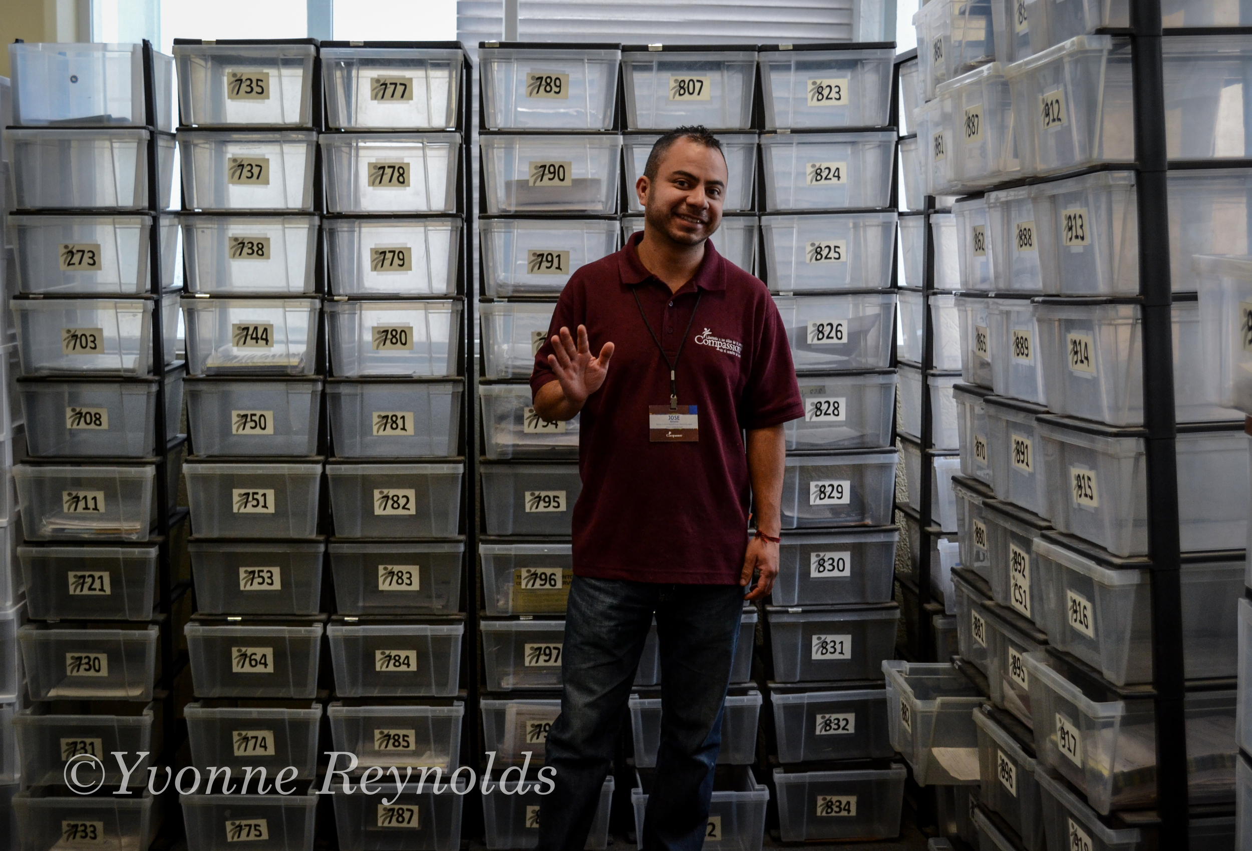 Antonio showing us the many boxes which are used to sort sponsor letters by project number.