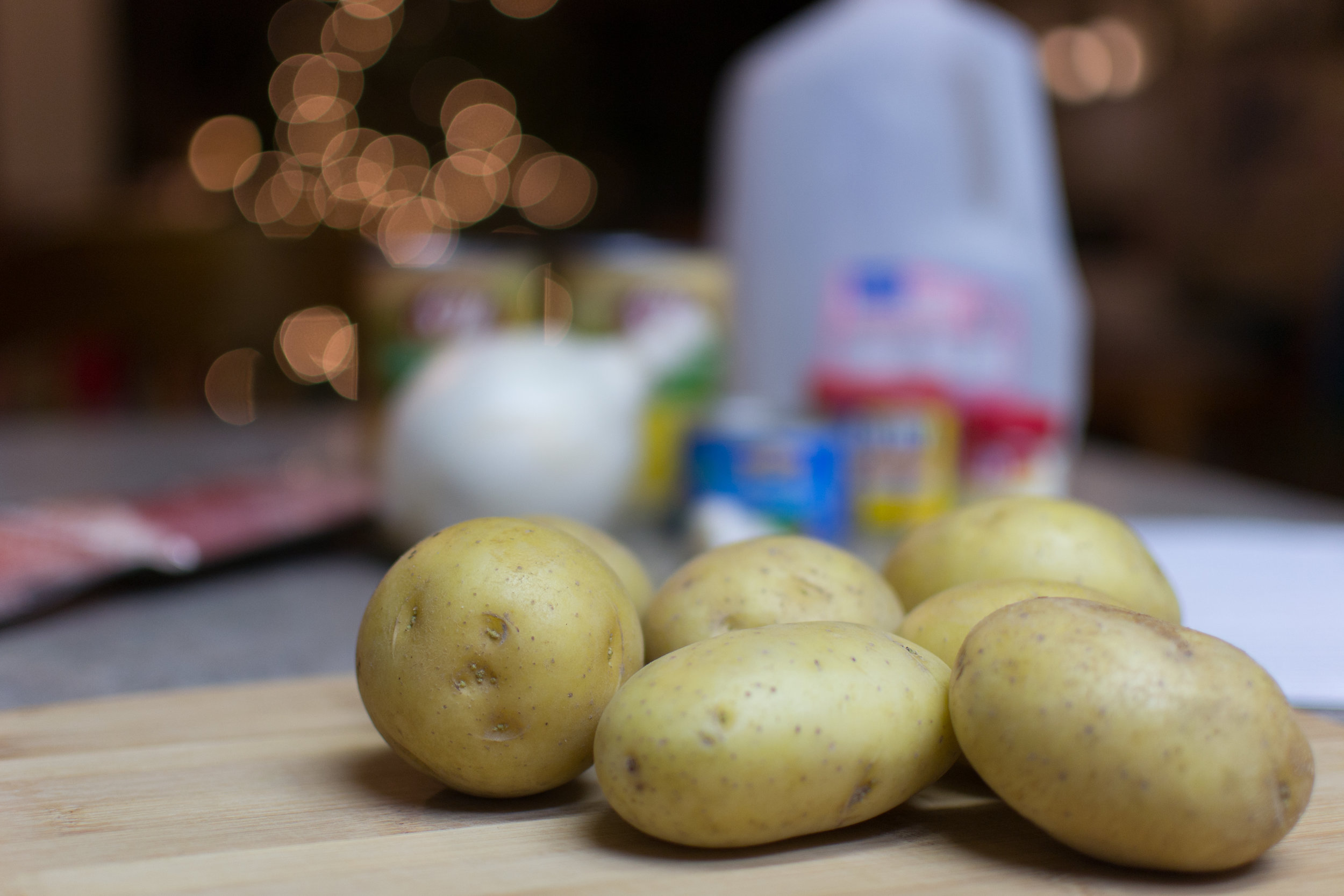 Potatoes for a new soup recipe with our Christmas lights still in the background