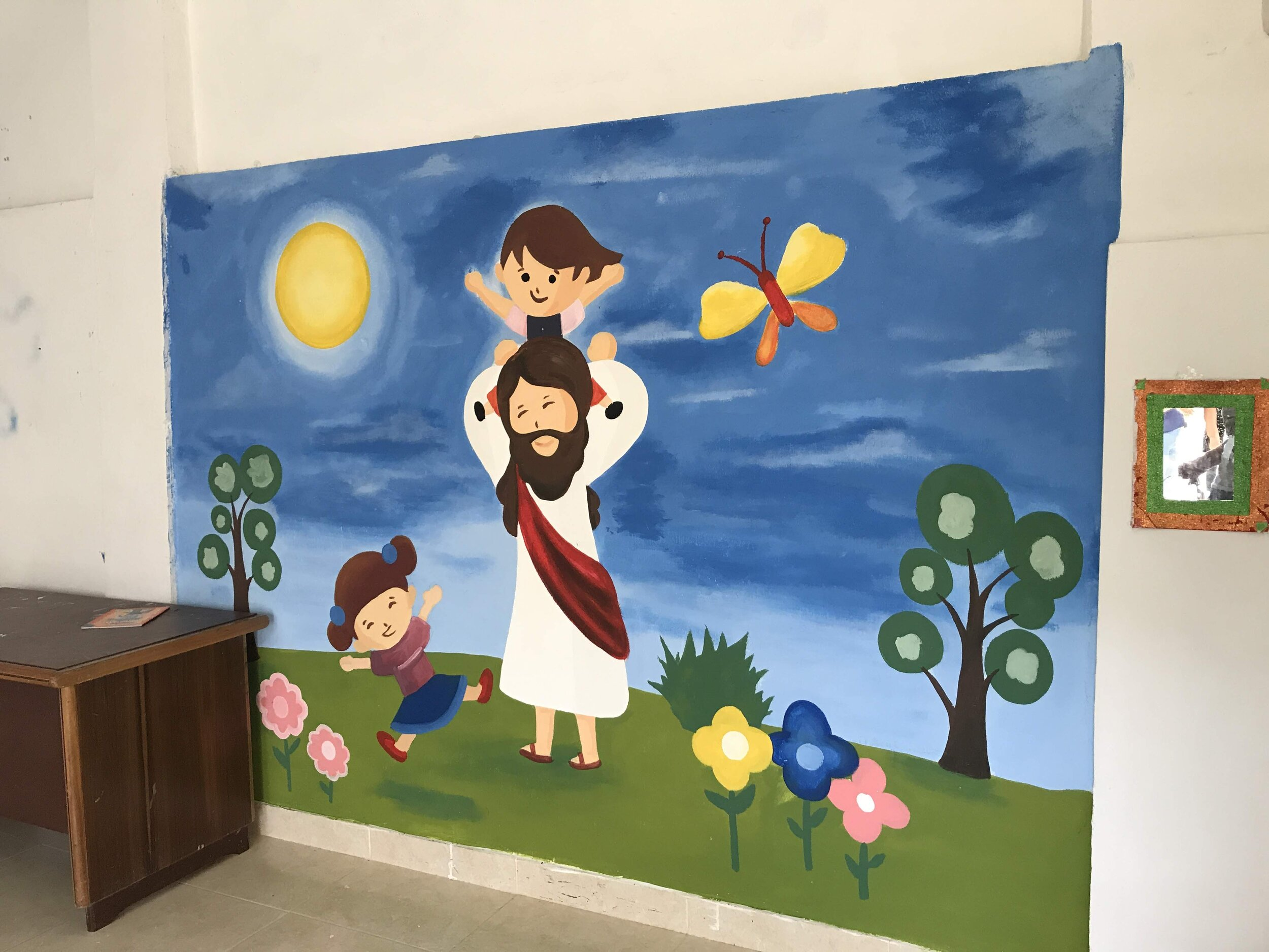 Mural of Jesus and children at Compassion center in Colombia