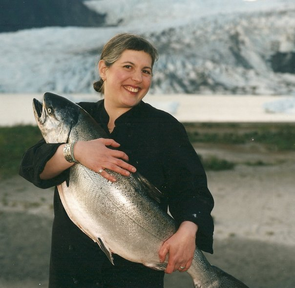 Salmon on ice! Taken in front of Mendenhall Glacier with 30# King salmon. (publicity photo for the Great American Seafood Cookoff 2004)