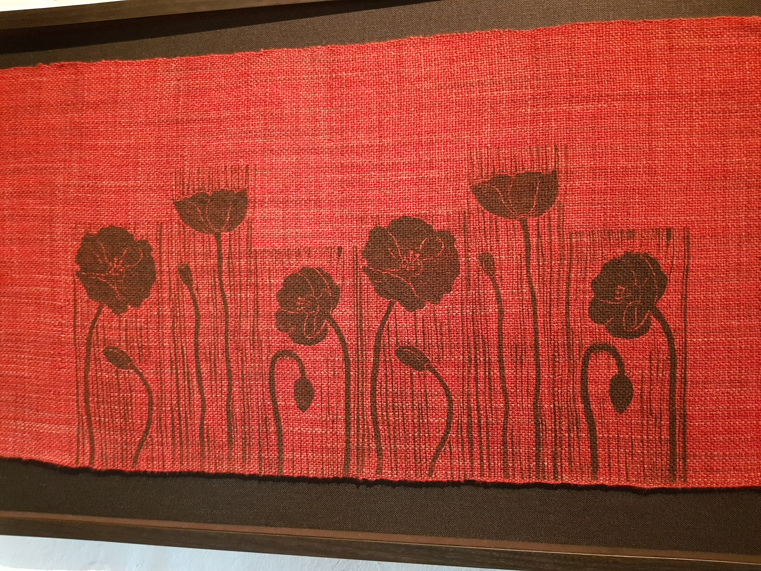 Linoprint Poppies on red textile MF.jpg