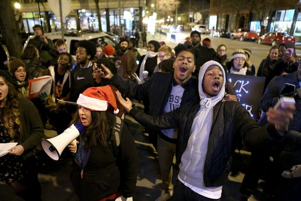 "Deray McKesson leads the carollers in a rendition of  ""Silent Night""  er,  ""Trampled Rights."""
