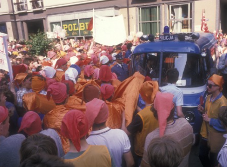 """""""Gnomes"""" with orange hats became the symbol of resistance in Poland, for interesting and hilarious reasons I can't go into here. But putting on a goofy orange hat became an easy entre for otherwise timid folks to join the parade for freedom from Communist oppression in the late 1980's."""