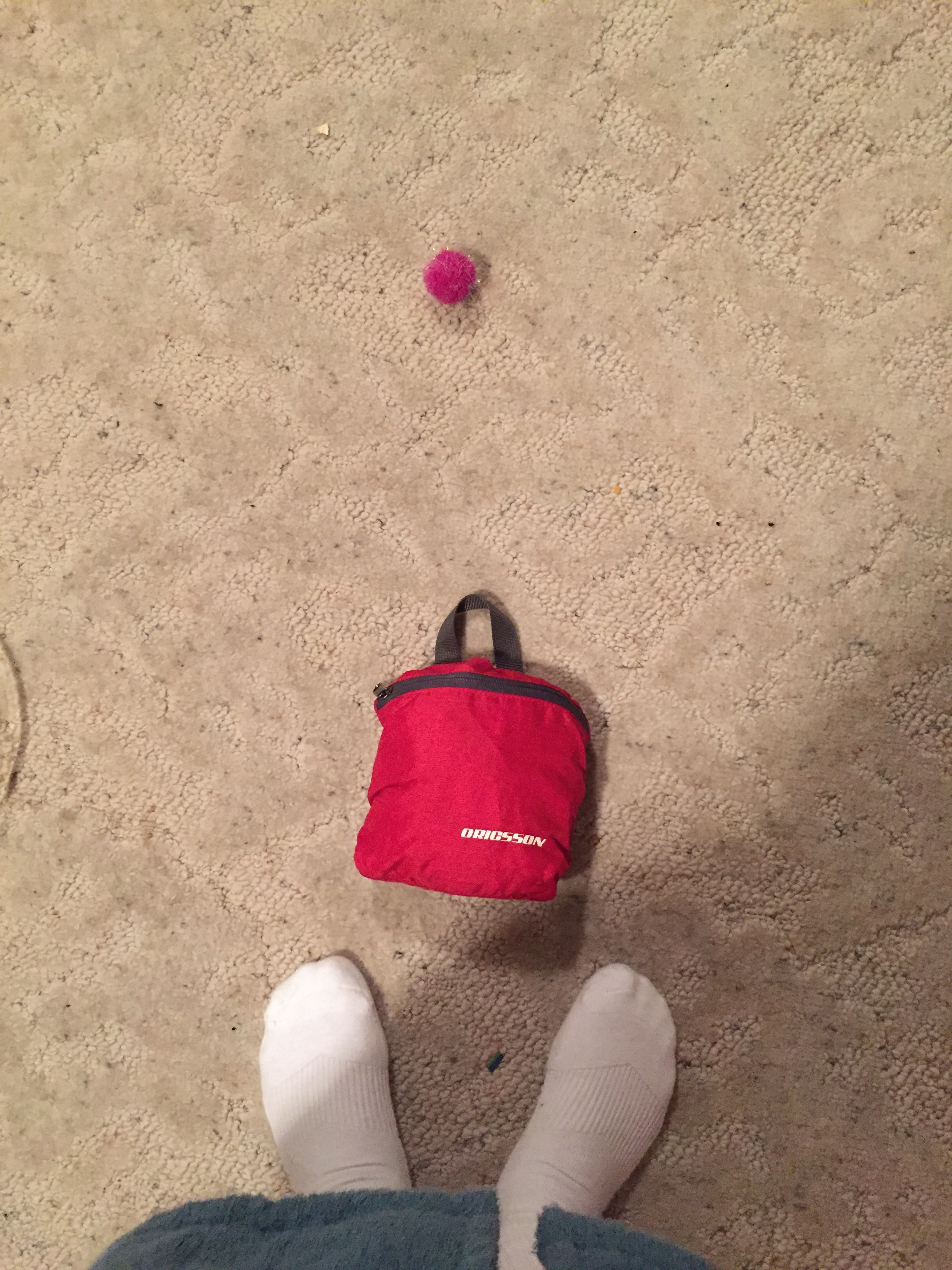 """This was my favorite """"travel-size"""" item on my recent trip to Europe: my backpack! Unzip this little purse and a backpack large enough to carry some (but not too much) stuff miraculously emerges!!"""