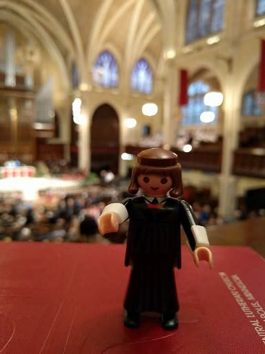My friend Rev. Bonnie Wilcox featured her Luther doll in a variety of arresting locales and posted them on FB.  Here he's getting ready to preach (NOT in Latin!)
