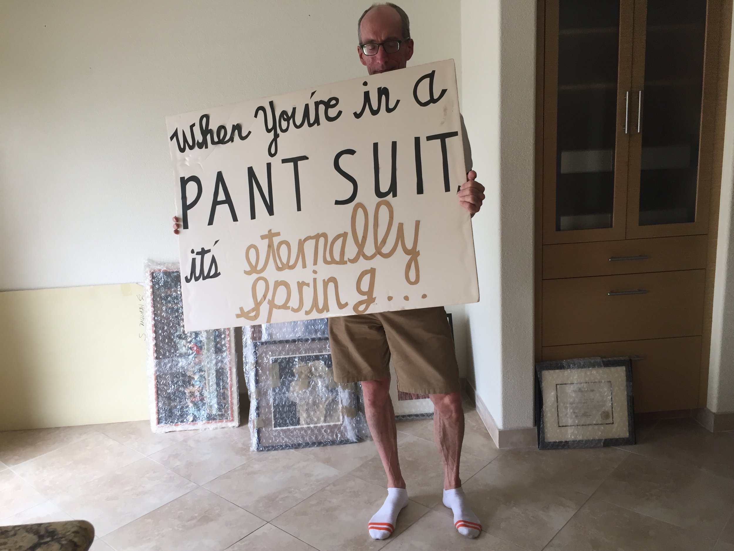 "Also proudly hanging in my new home is the sign I created when I and several friends marched in the Pasadena Doo-Dah parade 25 years ago. Yes, you'll find it in my ""Pant Suit Room."" (Lovely model not included.)"