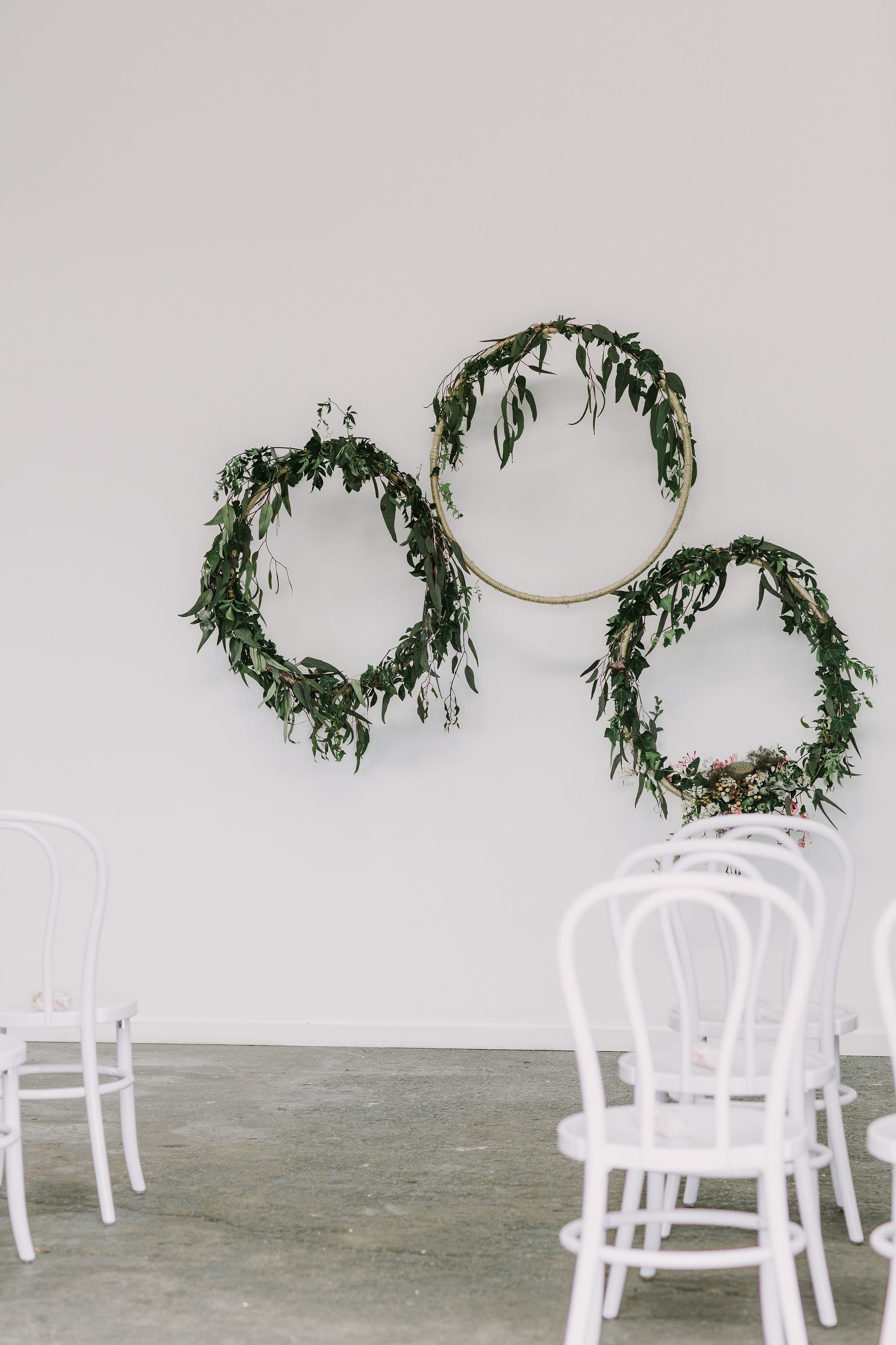 Native Australian flora add a simple, natural look to this ceremony backdrop at The Nook. Image credit:  Anitra Wells Photography.