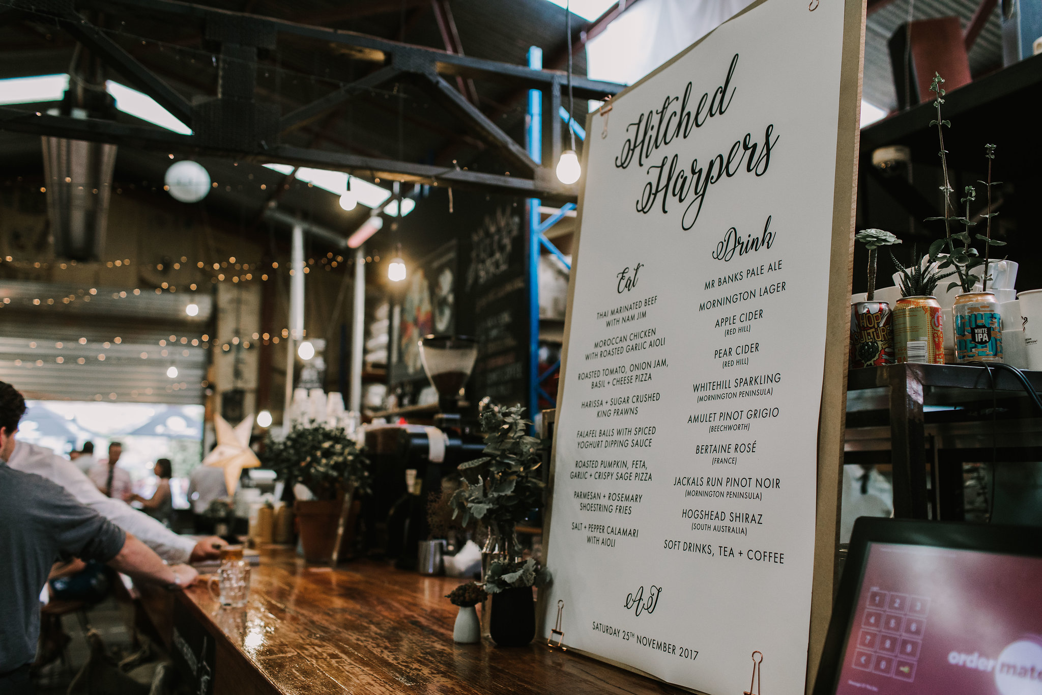 A menu sign adds a casual, low-maintenance touch to the reception. Image credit:  Anitra Wells Photography .