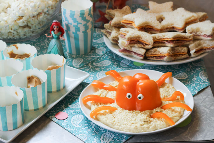 """Hummus with octopus (originally via  Better Homes and Gardens  but  found here ), peanut butter cups for  """"fishing"""" , and star shaped ham and cheese sandwiches."""