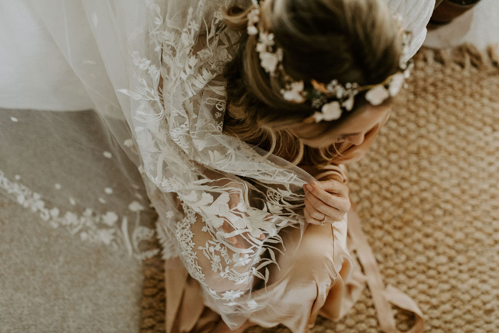 My custom veil had sweet nothings hand-stitched throughout the florals, including Que será será, from a song my mother used to sing to me when I was young.