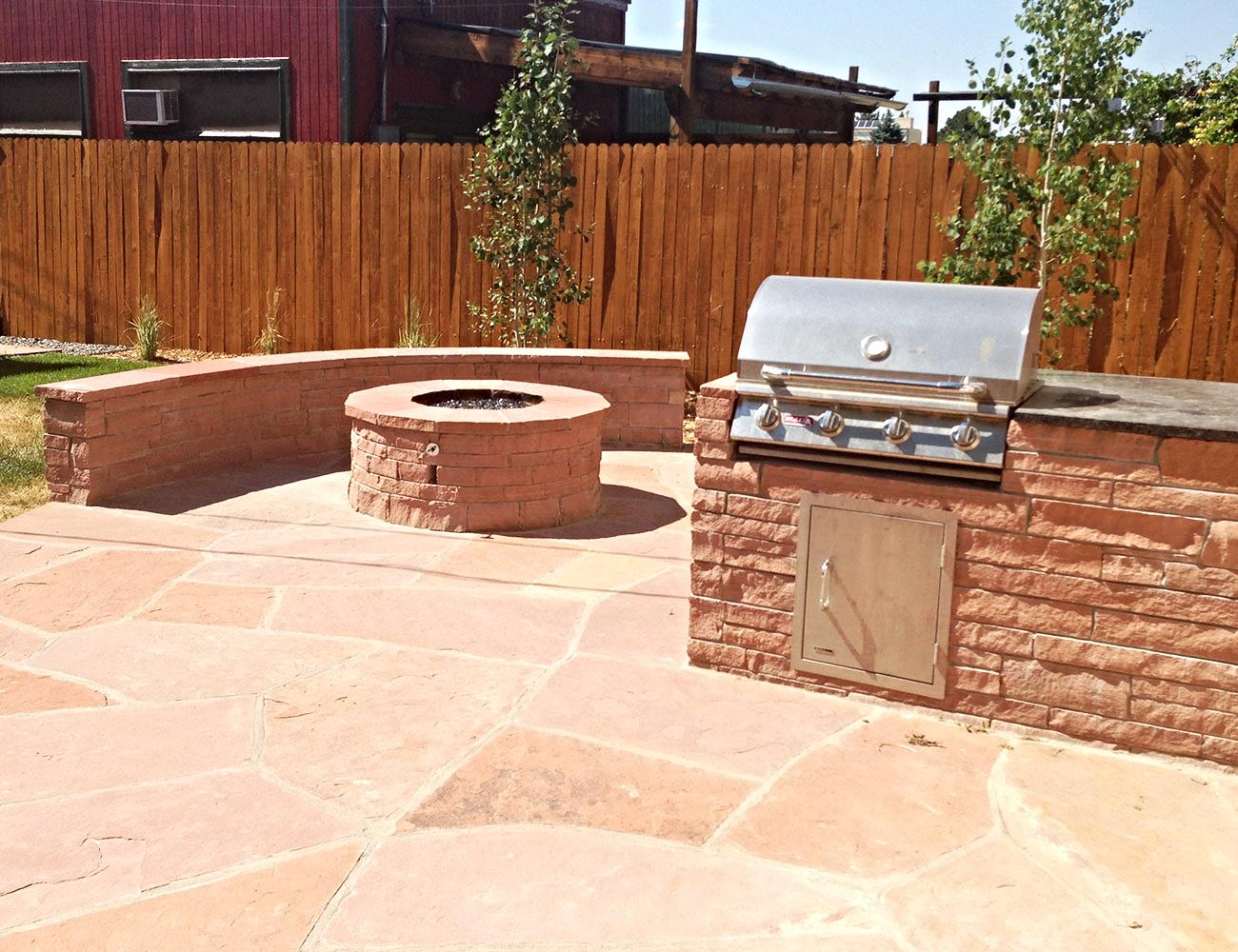 Red Flagstone Firepit & BBQ combo with Sitting Wall.