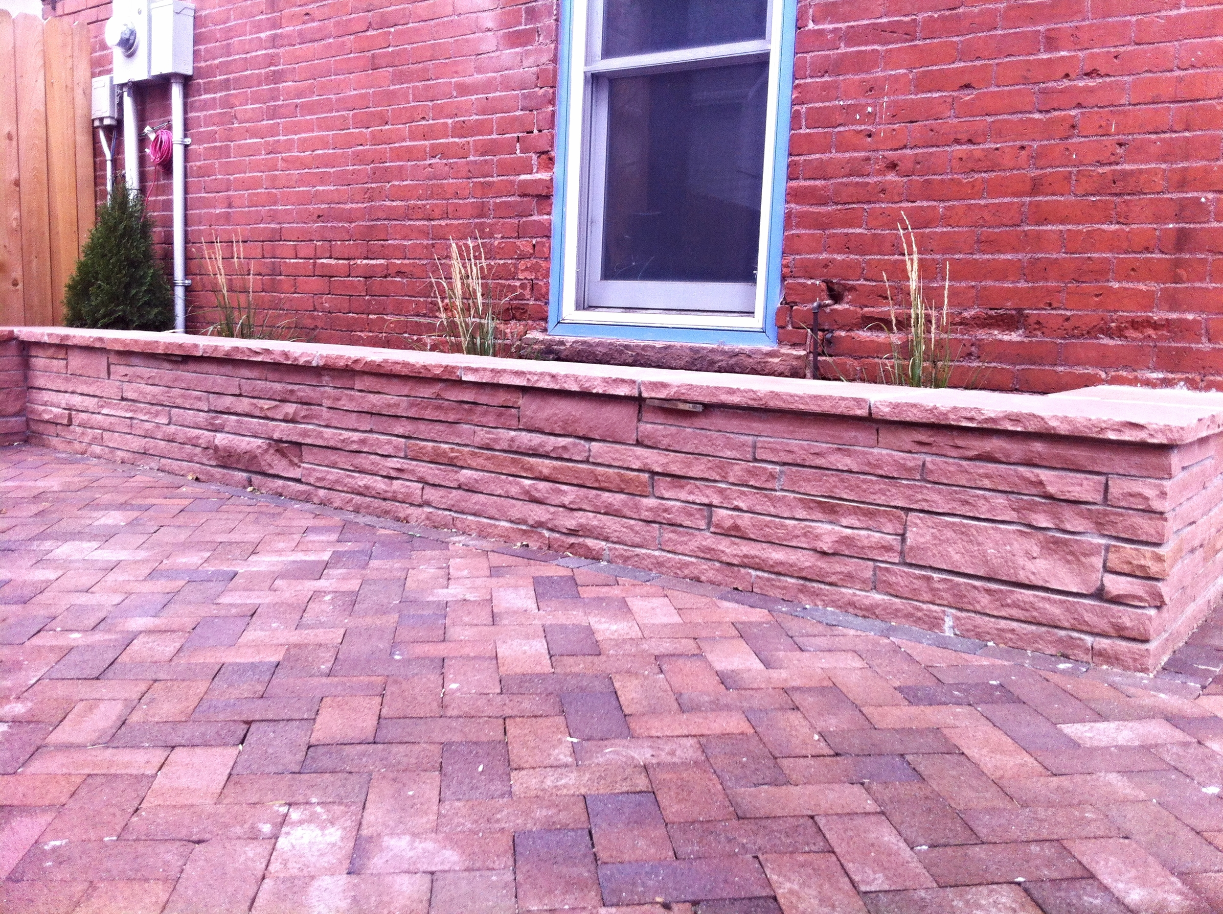 Paver Patio with Red Stripstone Sitting Wall.