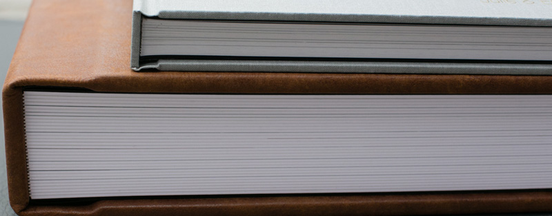 Top -Thin pages. Bottom -Thick pages are 2mm thick. They are a sturdy build that is constructed with a substrate between each page. For think pages add - 12x12 add $250.00, 10x10 add $220.00, 8x8 add $190.00