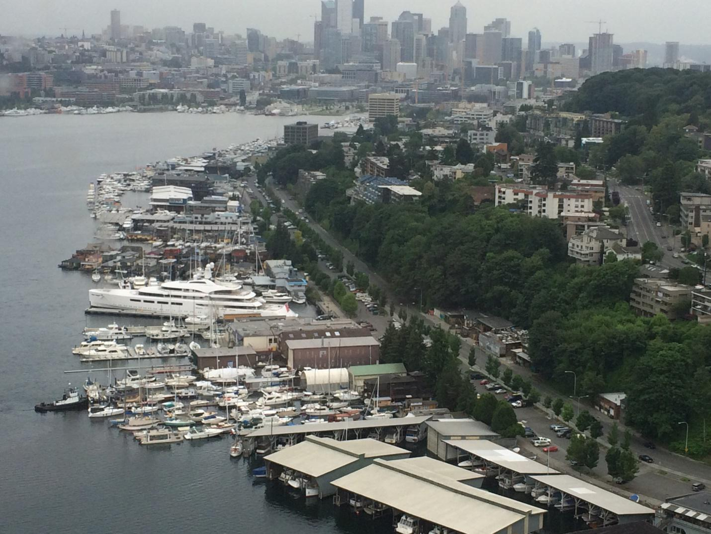 PICTURED ABOVE:  The 315-foot VAVA II dwarfs the other boats in Lake Union while an inspiring view of downtown Seattle is afforded from the Kenmore Air floatplane.