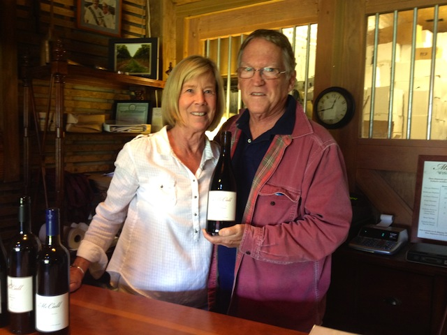 Photo by Rachel Young | Russ McCall, right, with his wife, Nicola Plimpton, holds a bottle of 2010 Pinot Noir Reserve.