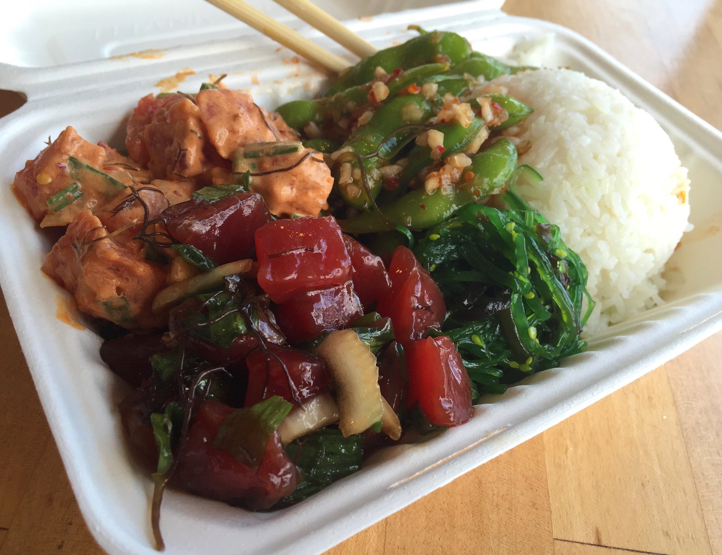 Pictured: Spicy poke, shoyu poke, spicy edamame, seaweed salad and white rice.
