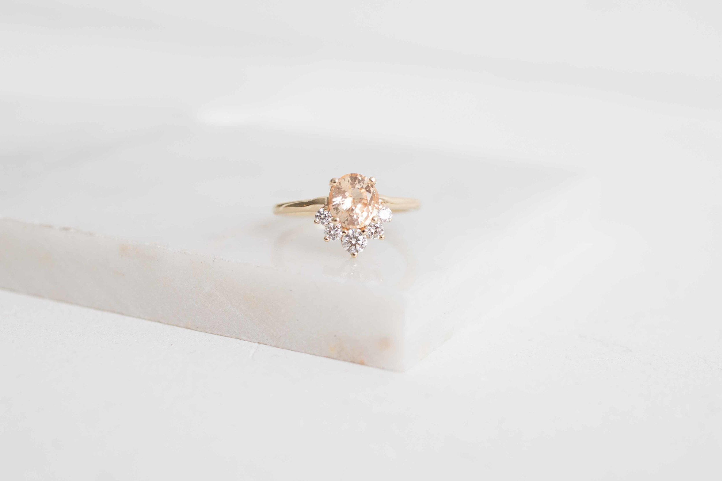Daniel Cooper Custom Oval Apricot Sapphire + Diamond Cluster Engagament Ring-4.jpg