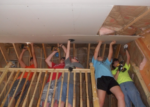 C.R.E.W. Youth Group hard at work during their annual summer mission trip.