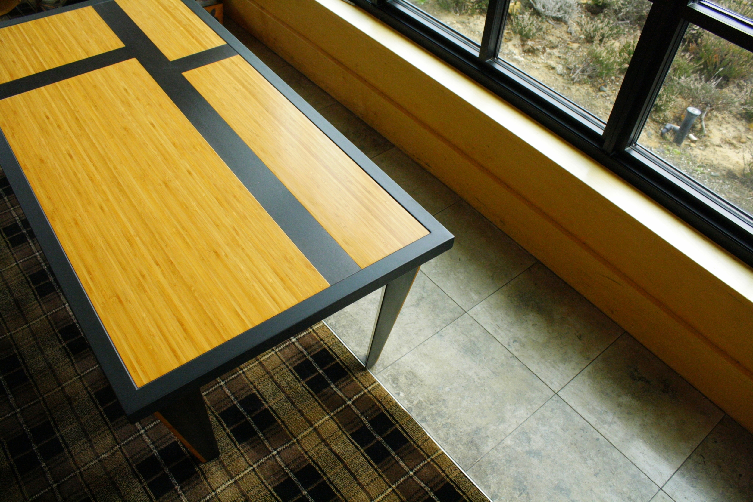 "Custom Bamboo Coffee Tables for Bandon Dunes Lounge  48"" x 24"" x 18"" Bamboo top with steel inlay and frame."
