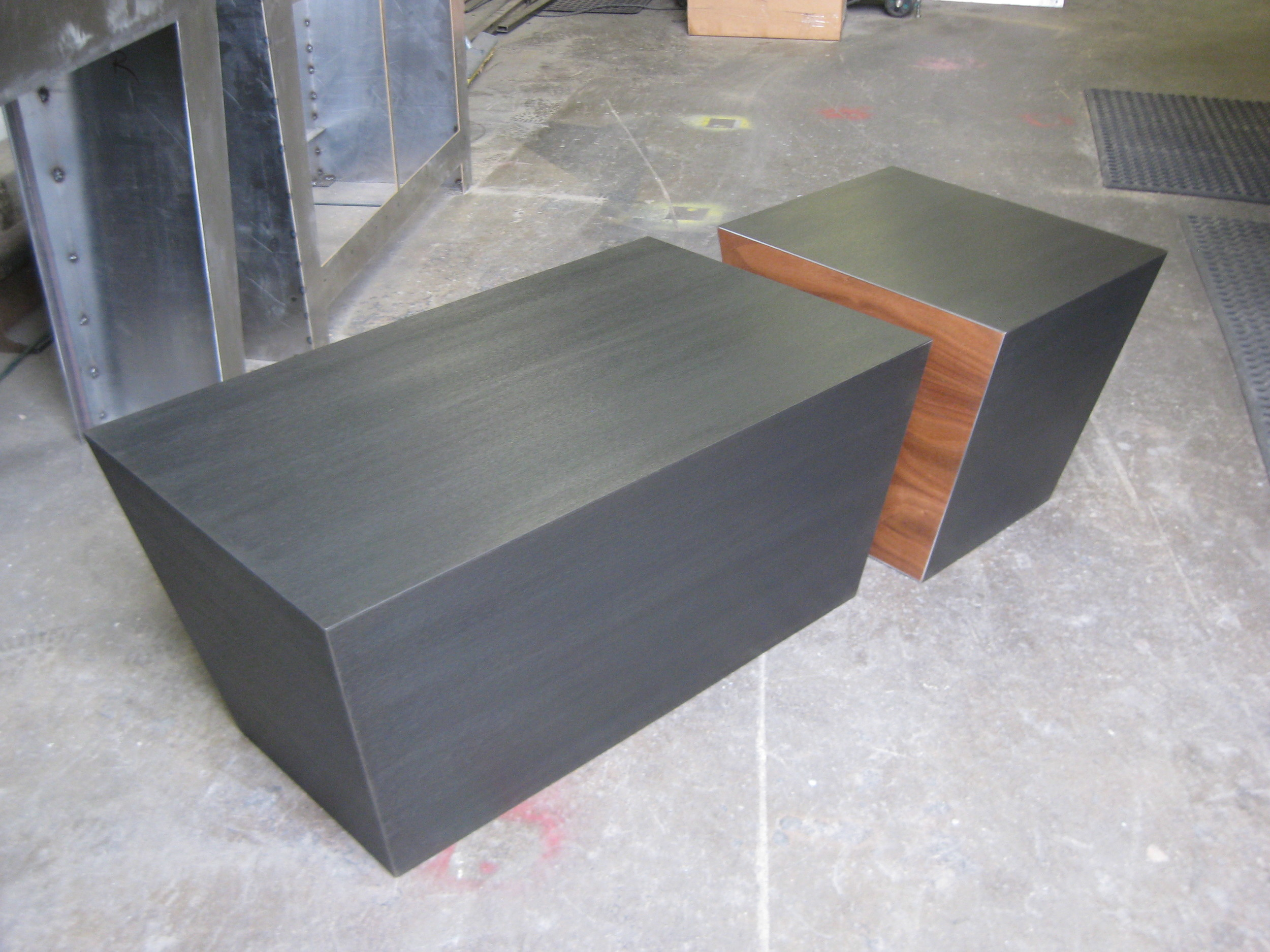 """Cube"" Coffee Table  Hand finished steel with a dark grey patina and one of a kind grain. Available in various wood inlay options, shown in walnut. Finished with a durable, water based matte/semi-gloss clear coat."