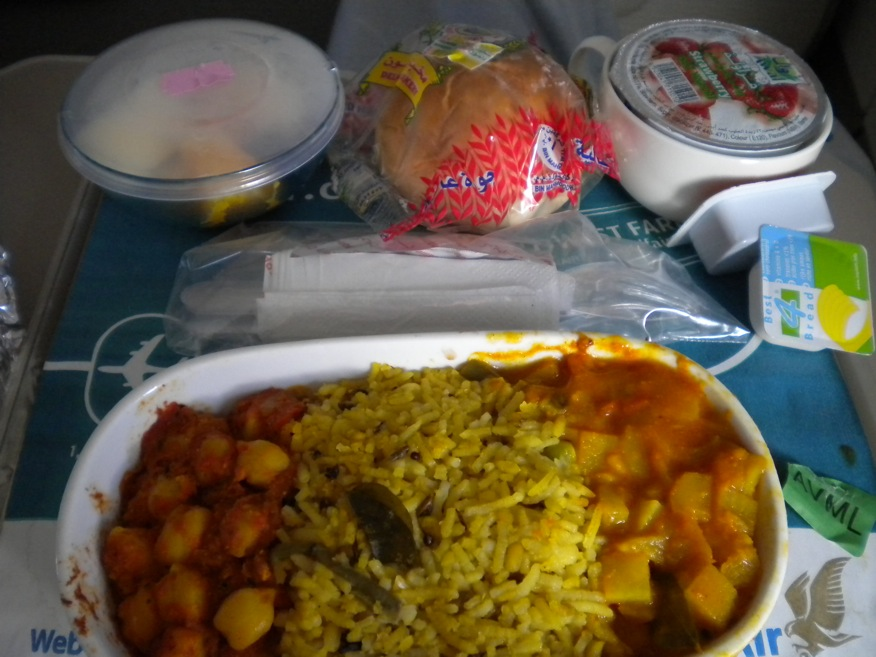 My yummy vegetarian meal on Gulf Air. Chana Masala, Saffron rice, and some sort of Makhani Paneer type dish.