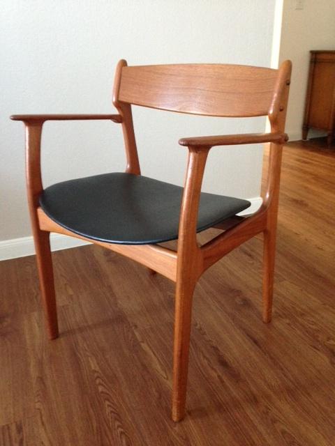 Rosewood mid-century modern arm chair by Erik Buch