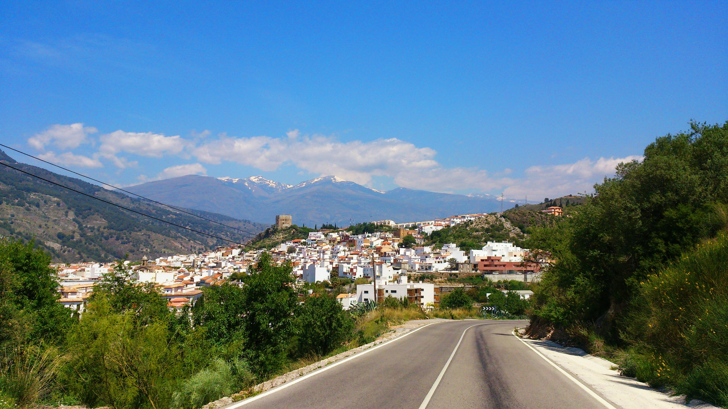 Velez de Benaudalla with the Sierra Nevada in the background.