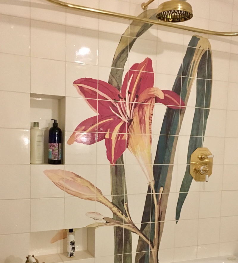 This colourful giant lily was commissioned to go on an eight foot wall behind a bath.  I painted the artwork on seven pieces of paper in order to get the best resolution.  Below you will see the route from artwork to making the grid and the final tiles are here.