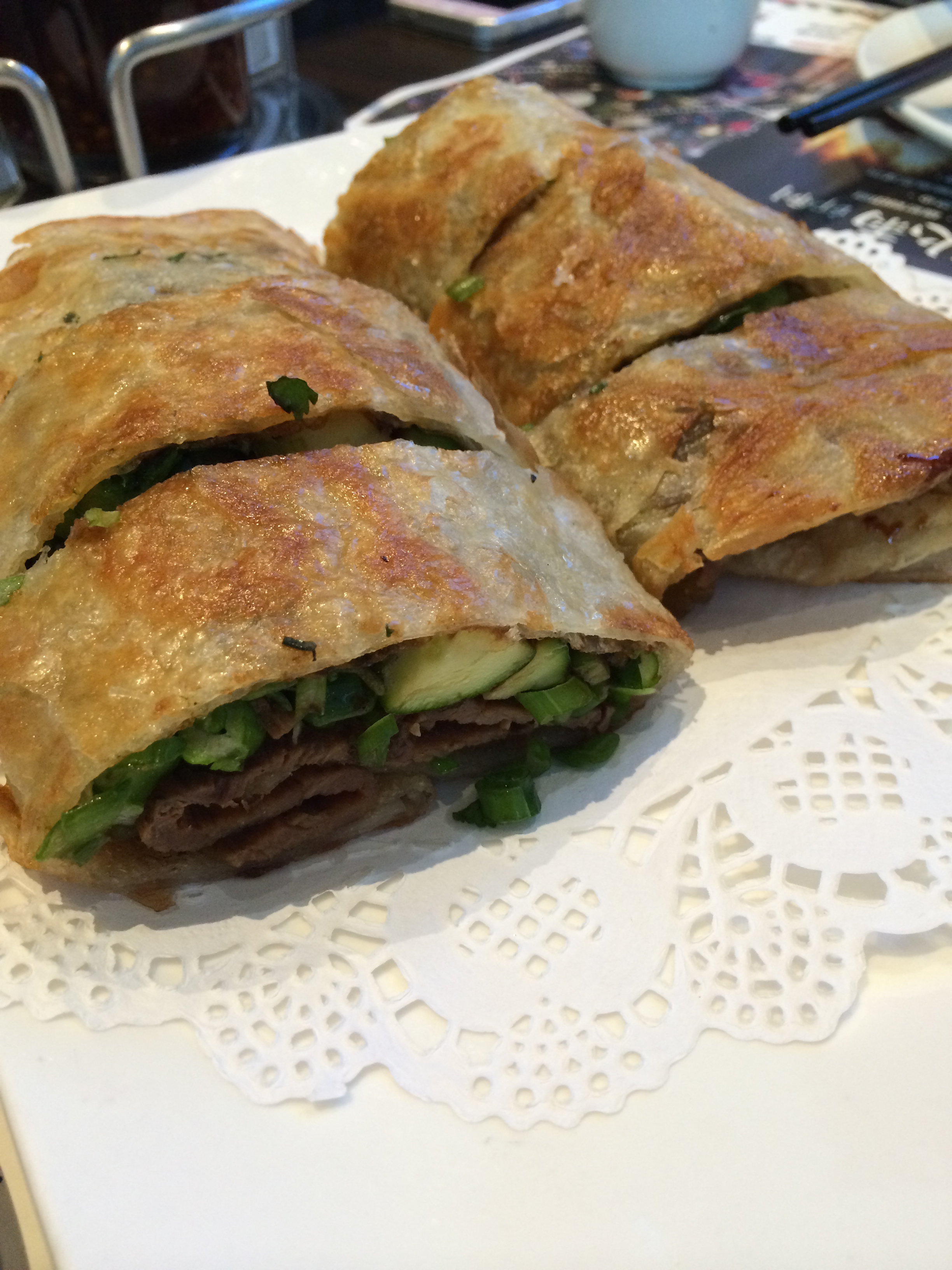 Beef roll - green onion pancake with beef, cilantro, cucumber and asparagus