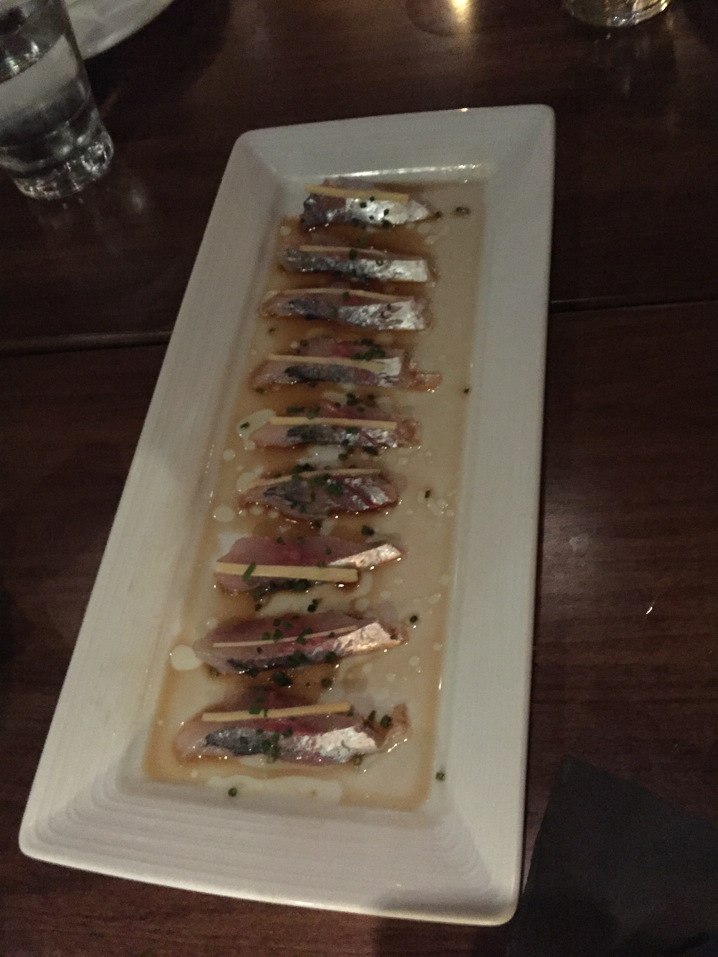 Aji - Spanish Mackerel, with ginger sliver, in ponzu sauce with a sprinkling of chive