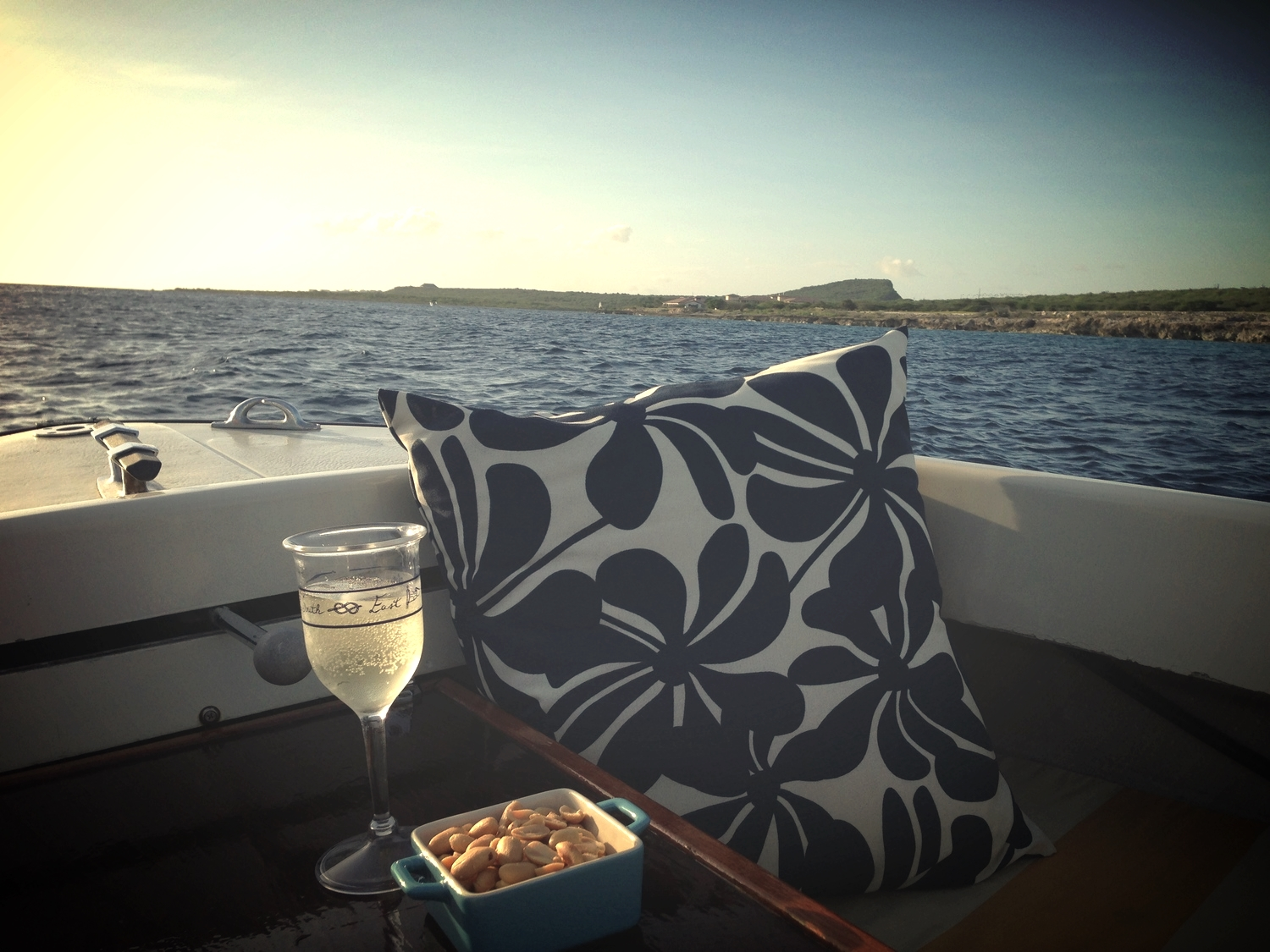 And if possible, take the boat out for a ride. It soothes the soul. Pillow by Bernina Modes in Curacao.