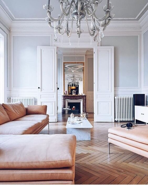 Image via  here.  Dream living room. Double doors, fire place, wooden floors. Perfection.