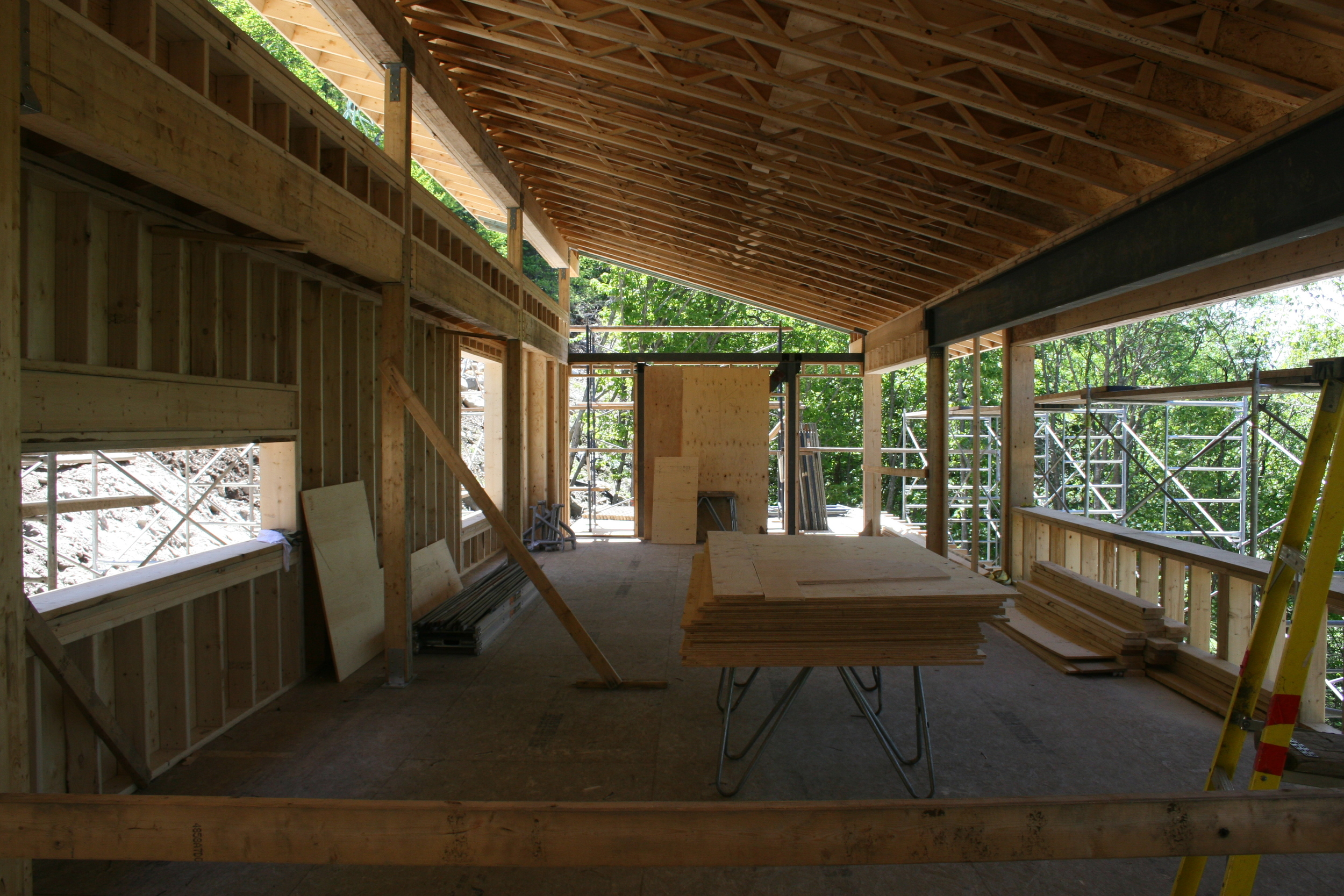 Kitchen and living room with exterior deck beyond