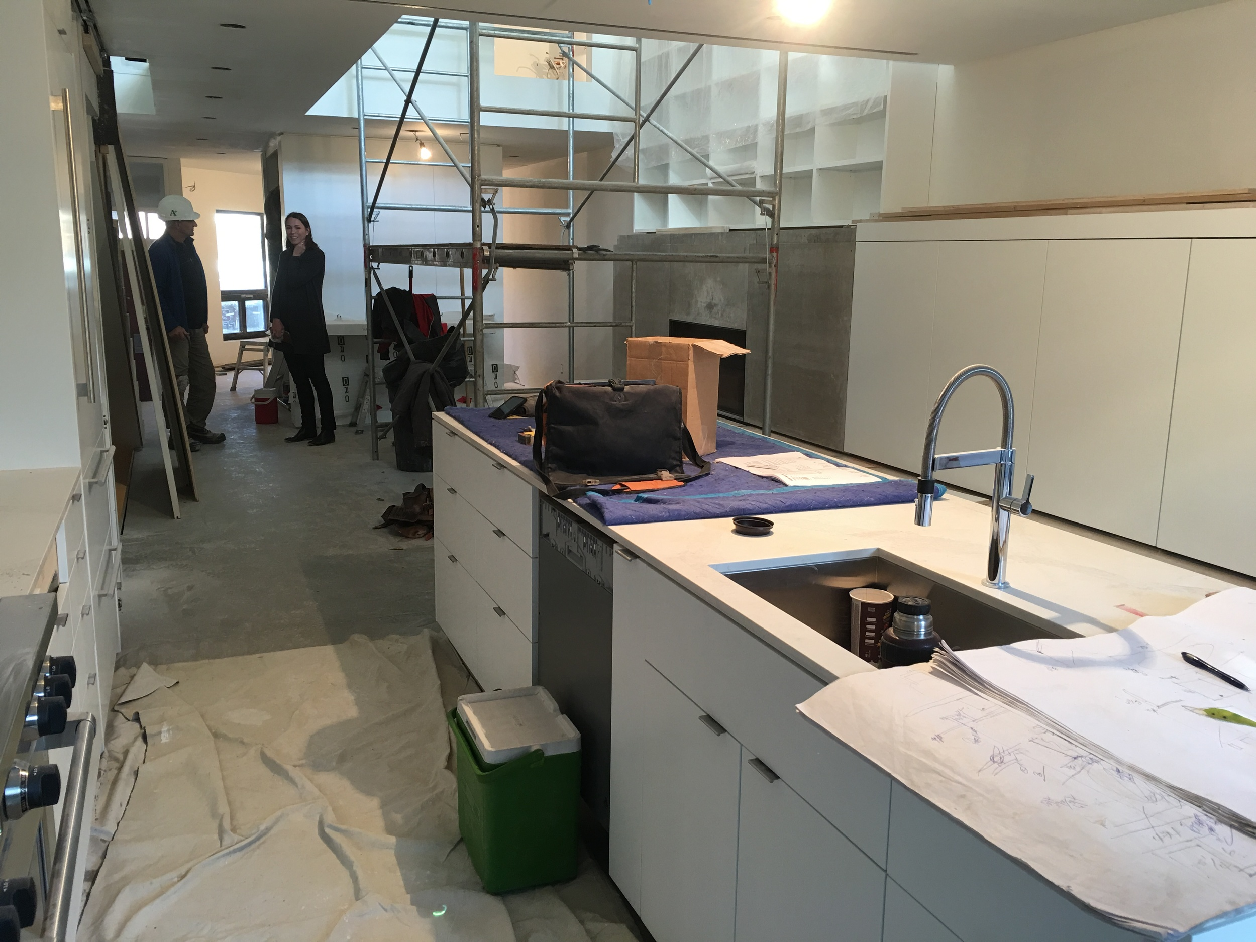 Millwork installation and painting - kitchen and atrium
