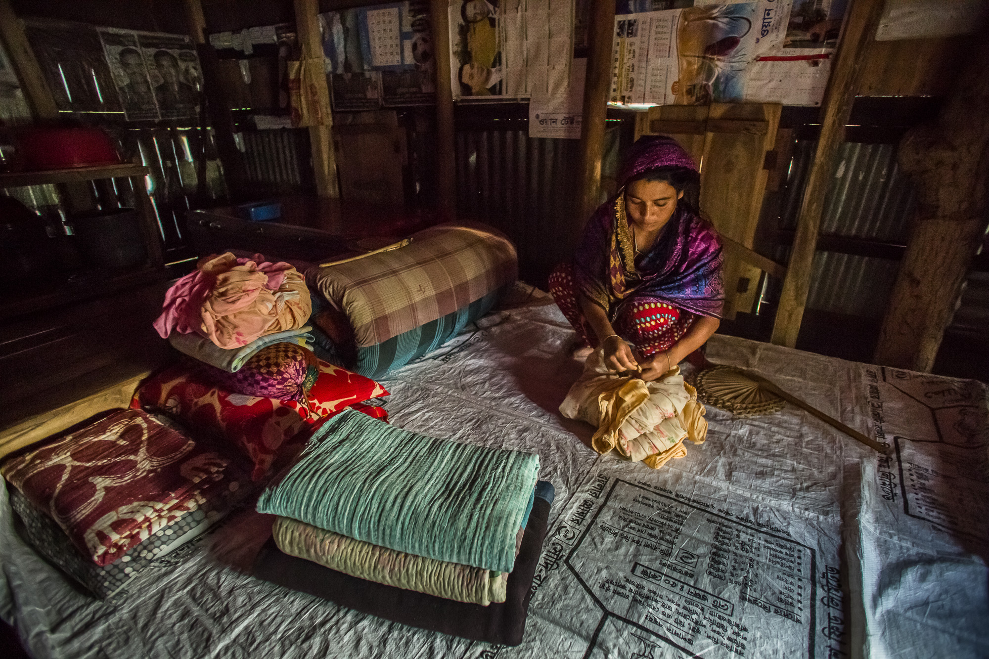 Ruma Begum, 28, a fish farmer in southern Bangladesh, doing chores at home.