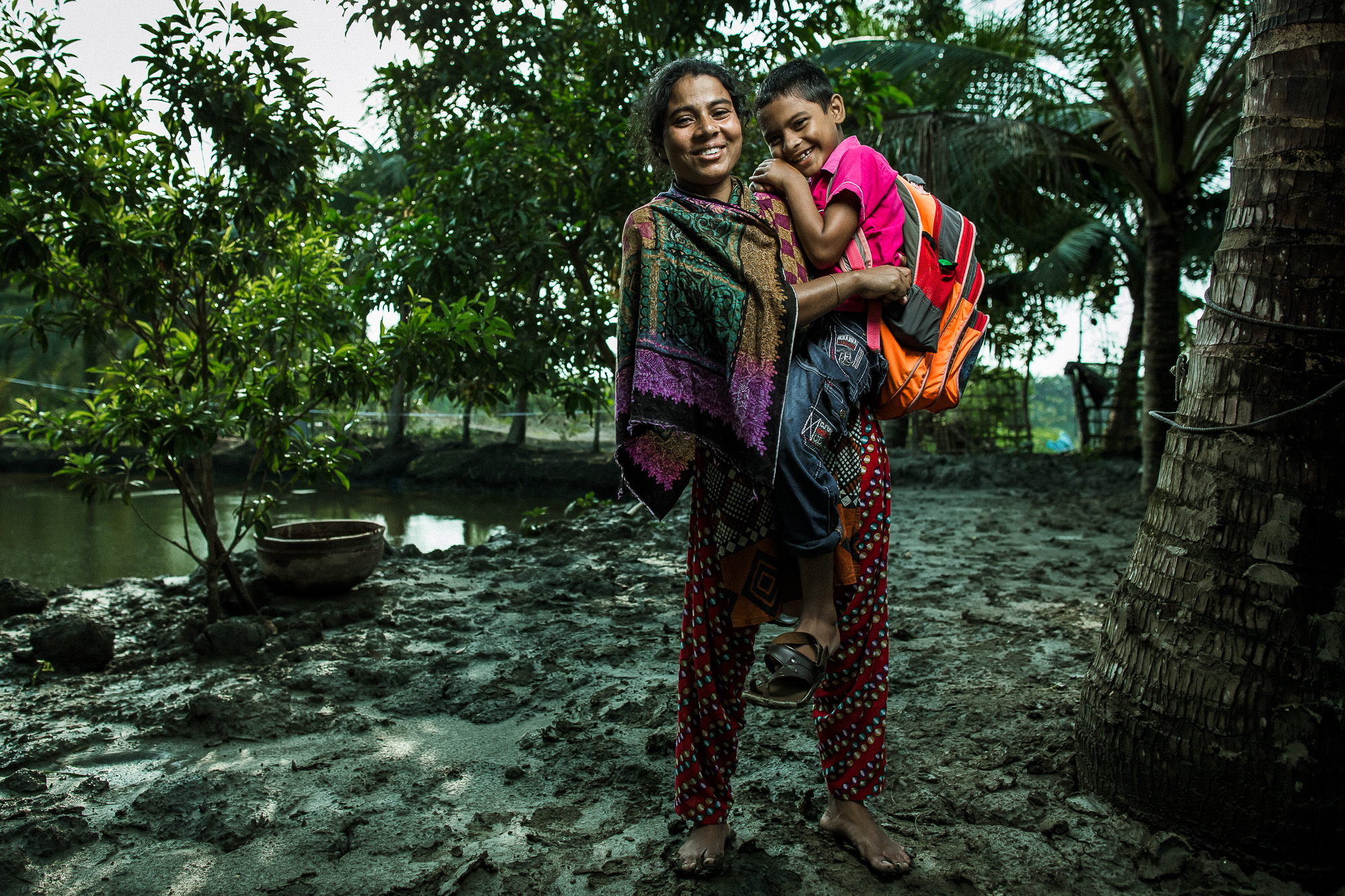 Ruma Begum, 28, a fish farmer in southern Bangladesh, and her son Bulbul.