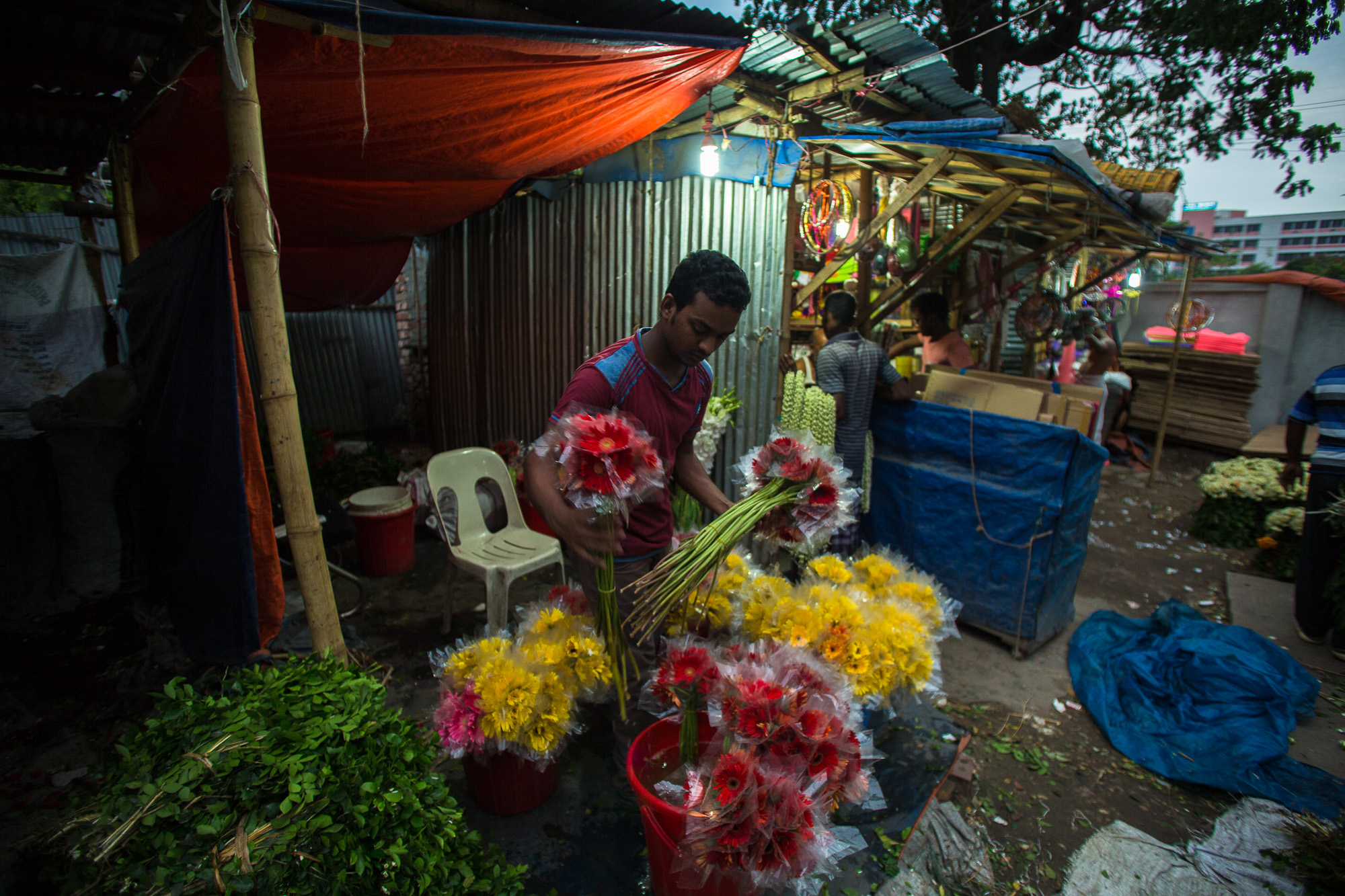 Flowers grown across Bangladesh arrive at the Agargaon Flower Wholesale Market in Dhaka where wholesale buyers purchase them and resell them to boutiques and flower stands throughout the city. Photo by Josh Estey