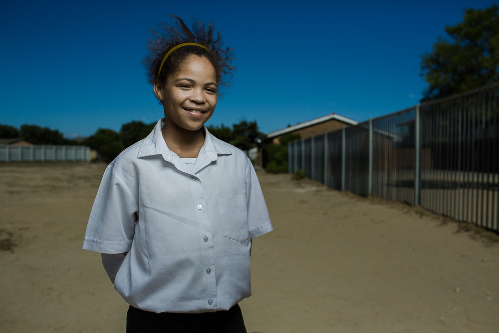 "MITCHELLS PLAIN, SOUTH AFRICA:  March 9, 2016 - Nakita Andrews, 12, is a student at Talfesig Primary School in Mitchell's Plain, a township outside of Cape Town, where Hillsong Africa Foundation provides an after school program called ""Lights On"" for primary‐aged children. They aim to add value to children's lives and instill in them a sense of purpose and worth, and hope for the future. They also work on addressing key issues the children face living in underprivileged communities, equipping them to deal with what life throws their way and how to move onwards and upwards in life. Photo by Morgana Wingard"