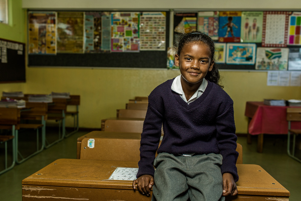 "MITCHELLS PLAIN, SOUTH AFRICA:  March 9, 2016 - Toufeegah Abrahams, 8,  is a student at Talfesig Primary School in Mitchell's Plain, a township outside of Cape Town, where Hillsong Africa Foundation provides an after school program called ""Lights On"" for primary‐aged children. They aim to add value to children's lives and instill in them a sense of purpose and worth, and hope for the future. They also work on addressing key issues the children face living in underprivileged communities, equipping them to deal with what life throws their way and how to move onwards and upwards in life. Photo by Morgana Wingard"