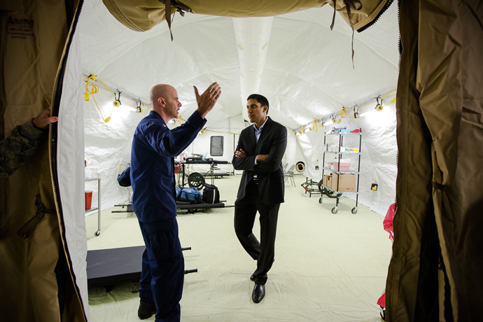 CAPT Ed Dieser (Engineer, USPHS Commissioned Corps Safety/Facilities Officer) gives USAID Administrator Raj Shah a tour of the new 25-bed critical care hospital for health workers who fall ill to Ebola while on the front lines of the outbreak in Liberia.