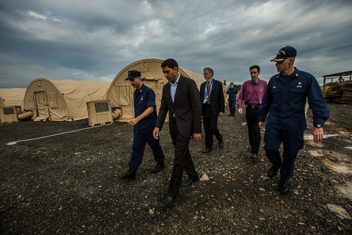 Rear Admiral Scott Giberson (Acting U.S. Deputy Surgeon General and Commander of the USPHS Commissioned Corps Ebola Response) gives USAID Administrator Raj Shah a tour of the 25-bed critical care hospital for all health workers who fall ill with Ebola while on the frontlines of the epidemic in Liberia on October 15, 2014.