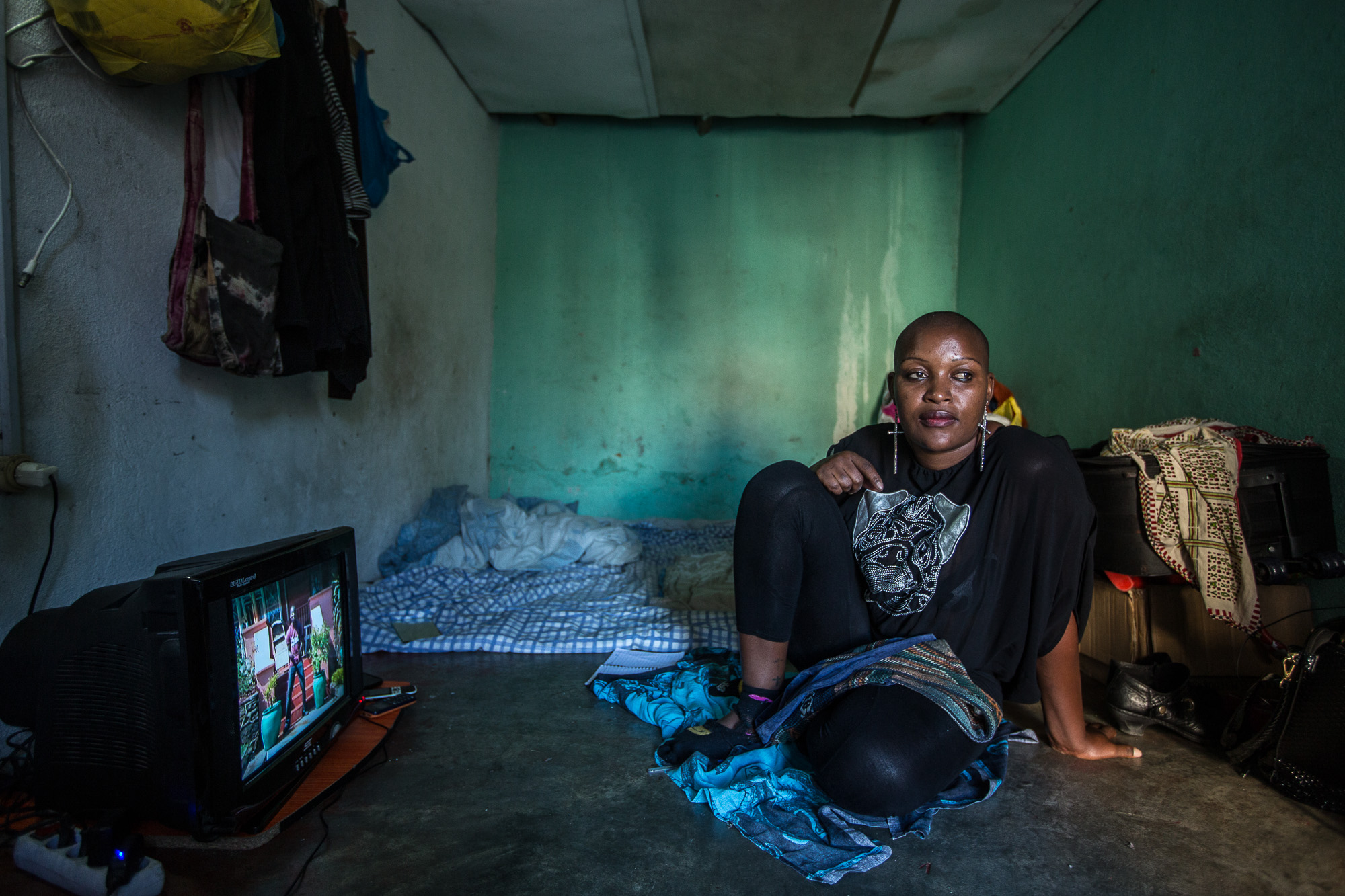 Precious, a commercial sex worker from Zimbabwe at her home in Beira, Mozambique.